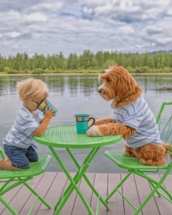 Boy Drinking Coffee With His Puppy Pa